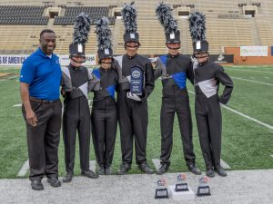 Rebel Regiment members receive award from Bands of America/Music for All president Eric Martin Esq.